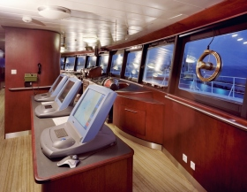 The fully digital bridge of the Freewinds, with its state-of-the-art Kelvin Hughes Radar system, and its panoramic windows, enabling a 360-degree view.